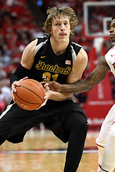14 February 2015:   Bobby Hunter reaches for a ball held by Ron Baker during an NCAA MVC (Missouri Valley Conference) men's basketball game between the Wichita State Shockers and the Illinois State Redbirds at Redbird Arena in Normal Illinois