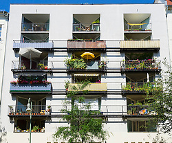 Balconies in summer in modern apartment building in Prenzlauer Berg district of Berlin Germany