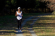 Goshen, New York - A woman runs along the Heritage Trail while competing in the Hambletonian Marathon fun run on Nov. 4, 2012. The run was put together for runners who had trained for the New York City Marathon, which was cancelled because of Hurricane Sandy.