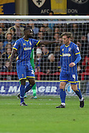Karleigh Osborne of AFC Wimbledon and Dannie Bulman of AFC Wimbledon in action during the Sky Bet League 2 match between AFC Wimbledon and Stevenage at the Cherry Red Records Stadium, Kingston, England on 12 December 2015. Photo by Stuart Butcher.