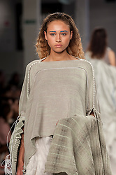 © Licensed to London News Pictures. 07/06/2016. London, UK. A model presents a look by Cavan McPherson from Manchester University.  Graduate Fashion Week, day three, takes place at the Old Truman Brewery in East London.  The event showcases the work of over 1,000 of the very best graduates from over 40 universities around the world through 22 catwalk shows and more.  Photo credit : Stephen Chung/LNP