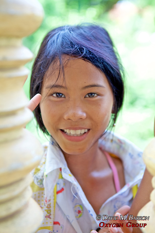 Young Local Girl Greets Tourists At Choeung Ek