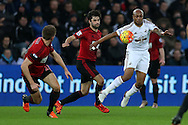 Andre Ayew of Swansea city (r) holds up the ball away from Claudio Yacob of West Brom ©. Barclays Premier league match, Swansea city v West Bromwich Albion at the Liberty Stadium in Swansea, South Wales  on Boxing Day Saturday 26th December 2015.<br /> pic by  Andrew Orchard, Andrew Orchard sports photography.