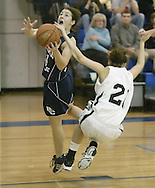 Katie Grahn, left, of John S. Burke Catholic takes a shot as Jane Walsh of Francis Lewis defends during the championship game of the Middletown holiday tournament in Middletown on Dec. 28, 2007.