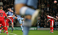 Photo: Paul Thomas.<br /> Manchester City v Middlesbrough. The Barclays Premiership. 30/10/2006.<br /> <br /> Richard Dunne (1st Blue from L) of Man City scores with a header.