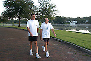 United States Senator Mel Martinez, left, and his brother, Ralph Martinez, go for an early-morning walk around Ralph's neighborhood in Orlando, Florida.   Sen. Mel Martinez represents the state of Florida, while Ralph Martinez is a member of the Foreign Claims Settlement Commission of the United States.