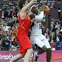12 August 2012: USA LeBron James drives past Spain Pau Gasol during 107-100 Team USA victory over Team Spain, during the men's Gold Medal Game, at the North Greenwich Arena, in London, Great Britain.