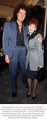 Musician BRIAN MAY and actress ANITA DOBSON at a reception in London on 8th October 2002.PDU 65