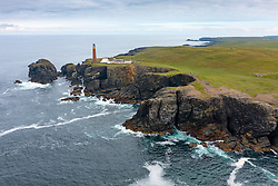Aerial view from drone of red brick Butt of Lewis lighthouse designed by David Stevenson, Isle of Lewis, Outer Hebrides, Scotland, UK
