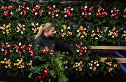 Alice Graham puts Christmas wreaths on display at the Smiddy Farm Shop near Doune, Stirling.