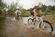 Rory van Zyl crosses a river during stage 1 of the 2014 Absa Cape Epic Mountain Bike stage race held from Arabella Wines in Robertson, South Africa on the 24 March 2014<br /> <br /> Photo by Greg Beadle/Cape Epic/SPORTZPICS