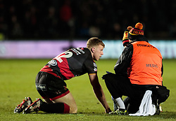 Dragons' Jack Dixon receives medical treatment<br /> <br /> Photographer Simon King/Replay Images<br /> <br /> Guinness Pro14 Round 10 - Dragons v Ulster - Friday 1st December 2017 - Rodney Parade - Newport<br /> <br /> World Copyright © 2017 Replay Images. All rights reserved. info@replayimages.co.uk - www.replayimages.co.uk
