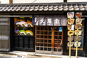 The Arai Bunsendo traditional Japanese handmade fan shop along Nakamise dori shopping street in Asakusa, Tokyo, Japan. The shop has been selling an making fans since the early 19th century.
