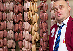 © Licensed to London News Pictures. 05/11/2012. London, UK. Comedian Al Murray is seen in Allen's of Mayfair, London's oldest Butchers shop, as he launches 'British Sausage Week' in London today (05/11/12). As part of the week, running from the 5th to the 11th of November, butchers across the country are challenging customers to make them laugh with their best sausage jokes which will be judged either a 'banger or a clanger'. Photo credit: Matt Cetti-Roberts/LNP