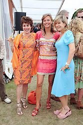 Left to right, RUBY WAX, SIOBHAN BARNEY and PENNY SMITH at the Veuve Clicquot Gold Cup polo final held at Cowdray Park, Midhurst, West Sussex on 18th July 2010.