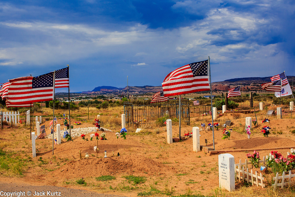 13 JULY 2012 - WINDOW ROCK, AZ:   American flags on graves in the Navajo Veterans' Cemetery. More than 300 Navajo veterans are buried in the Veterans' Memorial Cemetery north of Window Rock, AZ, on BIA Highway 12. The cemetery is in the windswept high desert. Members of the military killed overseas are returned to the reservation for burial. The tribe has set aside 10 acres in Chinle, in the center of the reservation, but that site is awaiting funding from Washington.      PHOTO BY JACK KURTZ