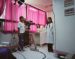 A soap opera depicting Overseas Filipino Worker, OFW, life is filmed inside a hospital in Manila, Philippines on Dec. 2006.  OFW life permeates pop culture in the Philippines with popular singers and television programs among other things, targeting families and workers. In this particular program, an OFW visits the hospital after learning that he has contracted HIV from being promiscuous while abroad. He later finds out that he may have infected his pregnant wife.