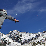 A skier heads for a crash landing takes to the air at The Remarkables Ski Fields, Queenstown, New Zealand during a session with 'The Air Bag'  a large inflatable airbag which breaks the fall of the participant on landing and allows valuable experience and a training aid for Aerial skiers and snowboarders. Queenstown, South Island, New Zealand, 23rd July 2011