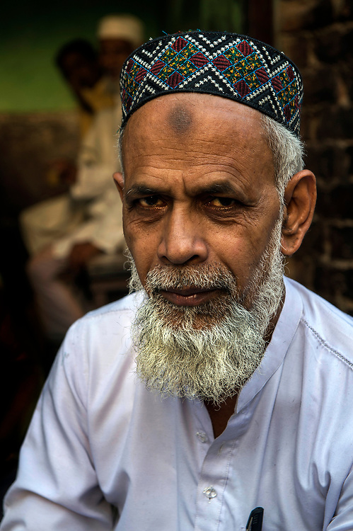 Portrait of a devout moslem man, moslem quarter, Varanasi.Notice the burnished forehead from prostrations to Allah.