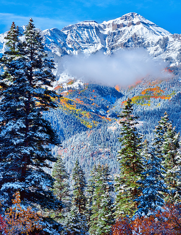 From the sugarcoated trees and the vibrant autumn colors to the snow-capped peak and the idyllic cloud hovering below the summit, all the elements came together on this perfect day to provide a gift of supreme beauty.