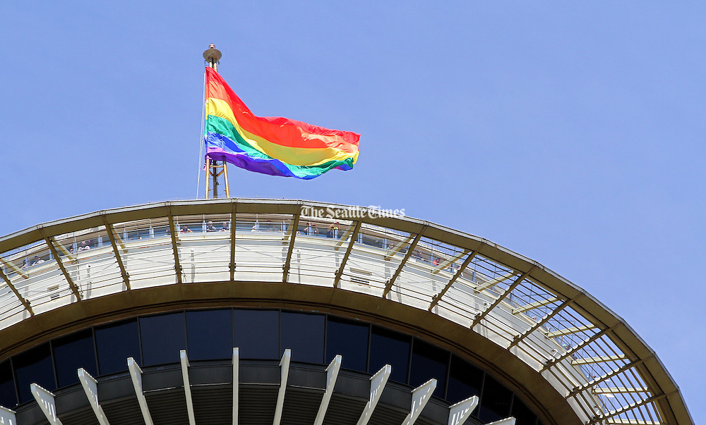A rainbow flag flies over The Space Needle.<br /> Ellen M. Banner/ The Seattle Times
