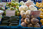 Vegetables for sale on market stall priced in sterling and imperial units