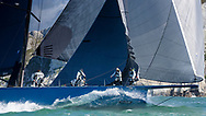 Mike Slade's super maxi, Leopard 3, passes The Needles lighthouse during the Round the Island Race. Isle of Wight.<br /> Picture date: Saturday July 2, 2016.<br /> Photograph by Christopher Ison ©<br /> 07544044177<br /> chris@christopherison.com<br /> www.christopherison.com