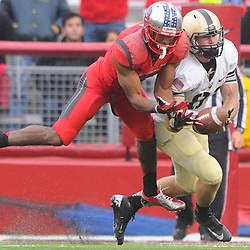 10 November 2012: Army Black Knights wide receiver Patrick Laird (81) has a reception broken up by Rutgers Scarlet Knights defensive back Logan Ryan (11) during NCAA college football action between the Rutgers Scarlet Knights and Army Black Knights at High Point Solutions Stadium in Piscataway, N.J.. Rutgers defeated Army 28-7.