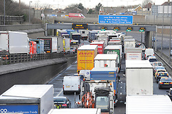 © Licensed to London News Pictures. 05/01/2012.Weather Chaos today 05.01.2012.M25 North towards Datford Tolls.Height winds have closed the Queen Elizabeth II Bridge at the Dartford Tolls in Kent, Traffic is backed up for miles in both directions as traffic has been reduced to using the tunnels..Photo credit : Grant Falvey/LNP