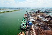 Nederland, Zuid-Holland, Rotterdam, 10-06-2015; Europoort, Ertsoverslagbedrijf Europoort C.V. (EECV) met bulk carriers voor de zeekade die worden gelost door grijperkranen. Dintelhavenhaven en Beneluxhaven.<br /> Europoort with bulk carriers at the terminals for dry bulk handling, ore and coal for German Steelmaking industry.<br /> <br /> luchtfoto (toeslag op standard tarieven);<br /> aerial photo (additional fee required);<br /> copyright foto/photo Siebe Swart