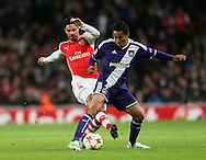 Arsenal's Mikel Arteta tussles with Anderlecht Andy Najar<br /> <br /> - Champions League Group D - Arsenal vs Anderlecht- Emirates Stadium - London - England - 4th November 2014  - Picture David Klein/Sportimage