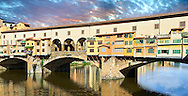"""Panoramic view of the medieval The Ponte Vecchio (""""Old Bridge"""") crossing the River Arno in the hiostoric centre of Florence, Italy, UNESCO World Heritage Site."""