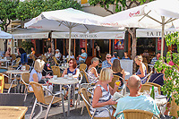 Pavement cafe, Estepona, Malaga Province, Spain, October, 2018, 201810080162<br /><br />Copyright Image from Victor Patterson, 54 Dorchester Park, Belfast, UK, BT9 6RJ<br /><br />t1: +44 28 9066 1296 (from Rep of Ireland 048 9066 1296)<br />t2: +44 28 9002 2446 (from Rep of Ireland 048 9002 2446)<br />m: +44 7802 353836<br /><br />e: victorpattersonbelfast@gmail.com<br /><br />The use of any of my copyright images is subject to my Terms & Conditions. It is IMPORTANT that you familiarise yourself with them. They are available at my website, victorpatterson.com.<br /><br />None of my copyright images may be used on the Internet unless they are visibly watermarked, i.e. © Victor Patterson within the body of the image. My metadata, denoting my copyright must NOT be deleted. <br /><br />Web use is extra at currently recommended NUJ rates. Maximum permitted web size is<br /> 400kb. <br /><br />Images must not be passed on to a third party - they are for the use of the authorised recipient only.