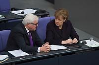 17 FEB 2016, BERLIN/GERMANY:<br /> Frank-Walter Steinmeier (L), SPD, Budnesaussenminister, und Angela Merkel (R), CDU, Bundeskanzlerin, im Gespraech, nach der Regierunsgerklaerung der Bundeskanzlerin zum Europaeischen Rat, Plenum, Deutscher Bundestag<br /> IMAGE: 20160217-03-047<br /> KEYWORDS: Debatte, Gespräch