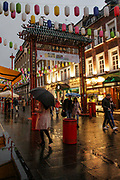 People holding umbrellas walk in China Town, in central London as heavy rain batters the capital on Friday, Oct 2, 2020. Forecasters warn Southern coastal areas of England could see gusts of up to 65mph and others could be at risk of flooding before the end of the weekend, as the French storm arriving on Friday is expected to be followed by another band of cold and blowy conditions. (VXP Photo/ Sabrina Merolla)