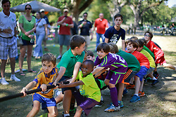 19 October 2014. New Orleans, Louisiana. <br /> Adults and kids compete in the tug of war at the New Orleans' Irish Network's third Family Day event with fun and games for kids and adults alike.<br /> Photo; Charlie Varley/varleypix.com