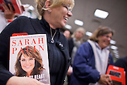 """23 NOVEMBER 2010 - PHOENIX, AZ:  MARY WHITE from Scottsdale, AZ, stands in line with her copies of Sarah Palin's new book, """"America by Heart"""" in Phoenix Tuesday. Palin signed copies of her new book, """"America by Heart"""" at the store in north Phoenix Tuesday night, Nov. 23. It was the kick off of her book tour to support America by Heart. Palin is frequently mentioned as a possible Republican candidate for US President in 2012.   Photo by Jack Kurtz"""