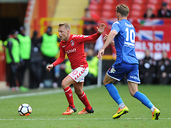 Charlton Athletic's Chris Solly (left) and Truro City's Cody Cooke battle for the ball