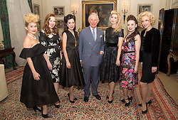The Prince of Wales poses with members of The Tootsie Rollers, as he hosts a reception to celebrate the 20th anniversary of the Walk the Walk charity at Clarence House, London.