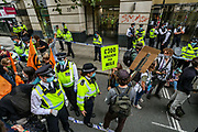Members of Extinction Rebellion activists group are protesting construction of HS2 outside Department for Transport in Horseferry Road in central London on Friday, Sept 4, 2020. There are other Extinction Rebellion protests ongoing in London. Police closed Horseferry Road both ways and is working to open it. Environmental nonviolent activists group Extinction Rebellion enters its 4th day of continuous ten days protests to disrupt political institutions throughout peaceful actions swarming central London into a standoff, demanding that central government obeys and delivers Climate Emergency bill. (VXP Photo/ Vudi Xhymshiti)
