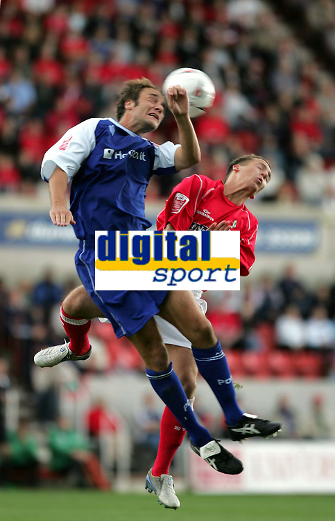 Photo:  Frances Leader.<br /> Swindon Town FC v Peterborough Utd.  Coca-Cola football league one.<br /> The County Ground.<br /> 11/09/2004<br /> Peterborough's Chris Plummer and Swindon's Brian Howard head the ball.