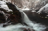 Waterfall in a forest at winter time