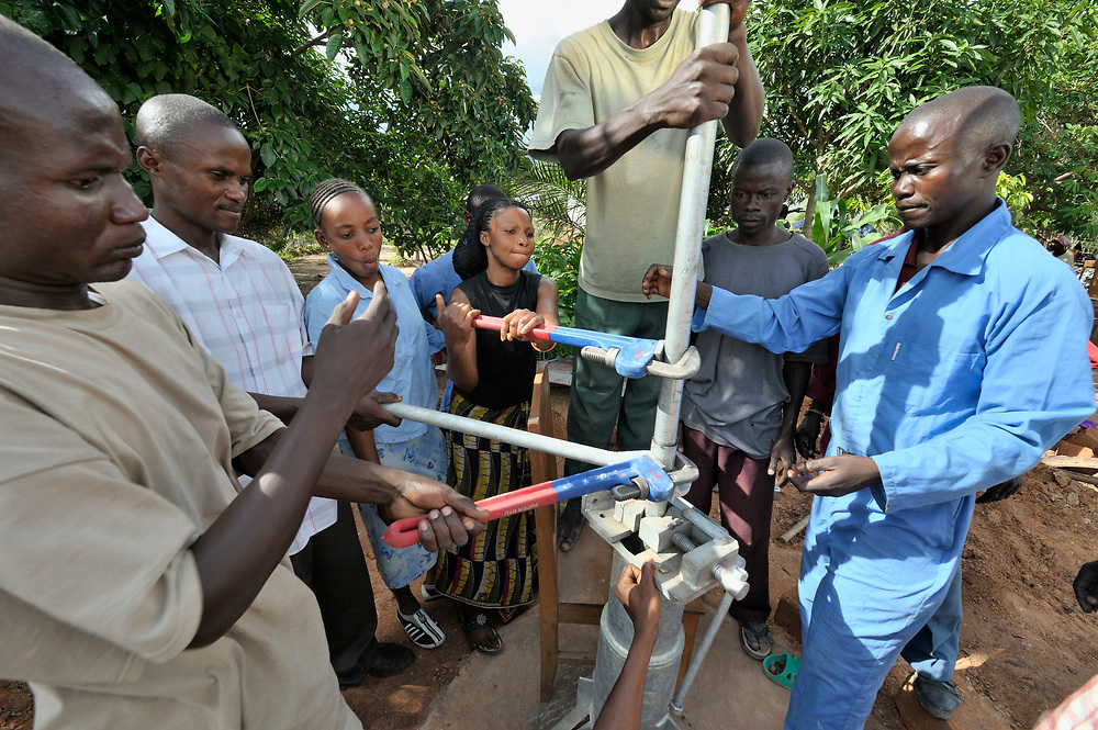 A group of neighbors in the Congo build a well together with assistance from the United Methodist Committee on Relief.