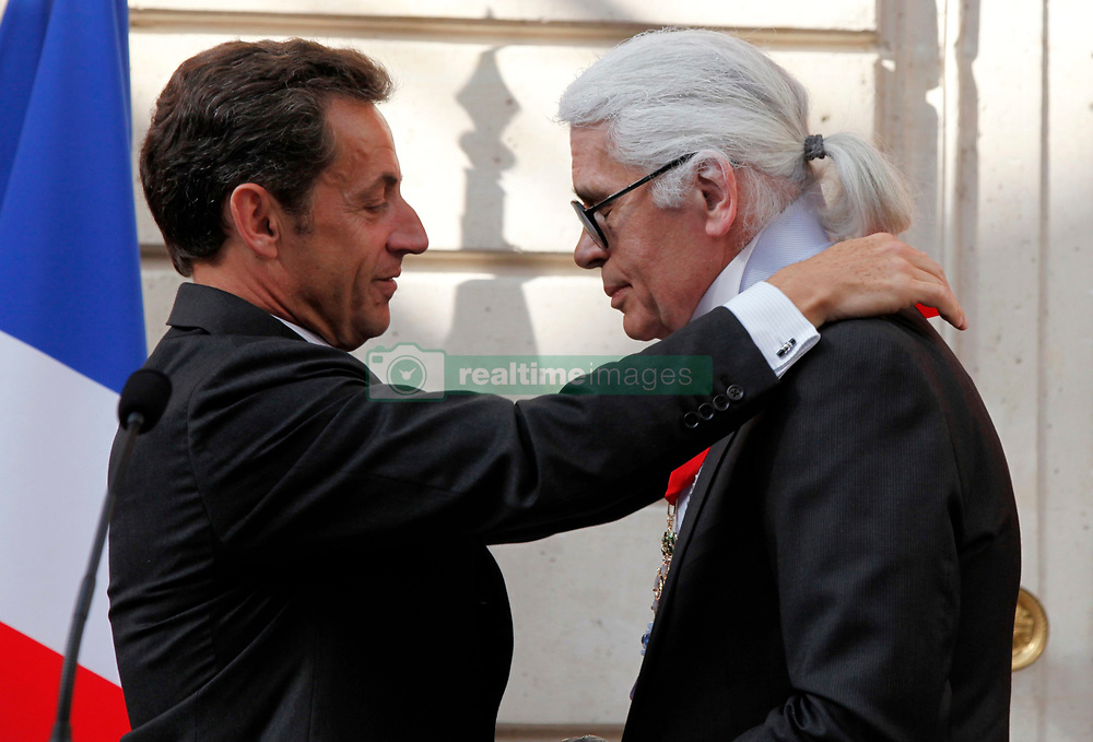German fashion designer Karl Lagerfeld (R) receives the Commander's Cross of the Legion of Honour (Croix de Commander de la Legion d'Honneur) from France's President Nicolas Sarkozy at a ceremony at the Elysee Palace in Paris, France on June 3, 2010. Photo by Jacky Naegelen/Pool/ABACAPRESS.COM