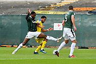 Andy Barcham (17) of AFC Wimbledon is challenged by Yann Songo'o (4) of Plymouth Argyle during the EFL Sky Bet League 1 match between Plymouth Argyle and AFC Wimbledon at Home Park, Plymouth, England on 6 October 2018.