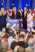 Billionaire and GOP presidential candidate Donald Trump acknowledges cheering supporters along with his wife Melania, daughter Ivanka and Lt. Gov. Henry McMasters as they celebrate victory in the South Carolina Republican primary February 20, 2016 in Spartanburg, South Carolina, USA .