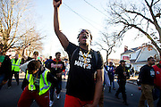 Christen Justice chants and raises his hand in solidarity during a protest in Madison, Wisconsin, March 11, 2015. Protestors rallied for the fifth day in a row, after the shooting death of Tony Robinson, Jr. by Madison Police inside his home on March 6, 2015. REUTERS/Ben Brewer (UNITED STATES)
