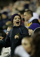 Photo: Dave Howarth.<br /> Wigan Athletic v Bolton Wanderers. Carling Cup.<br /> 20/12/2005.  A Wigan fan jubilant at Wigan's victory over Bolton
