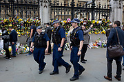 One week after the terrorist attack in the UK capital, Londoners and visitors to Britain pay their respects to the scene where flower memorials are left on Westminster Bridge where pedestrians were mown down by a car and outside the Palace of Westminster where armed police now guard the location where a police officer was killed, on 28th March 2017, London, England.