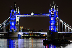© Licensed to London News Pictures. 23/07/2013. London, UK. Tower Bridge is illuminated in blue at night on 23 July 2013 to celebrate the Duchess of Cambridge giving birth to a baby boy and the future King of England. Photo credit : Vickie Flores/LNP